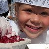 Record-Eagle/Douglas Tesner<br /> Molly Byrne, 4, from Traverse City, works on a 6-inch cherry pie during an event sponsored by Grand Traverse Pie Company in the Open Space.