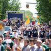 Record-Eagle/Jan-Michael Stump<br /> The Traverse City St. Francis football team makes its way down Front Street during Saturday's National Cherry Festival Cherry Royale Parade