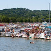 Record-Eagle/Douglas Tesner<br /> Hundreds of boats jam the shore line near West End Beach on opening day of the National Cherry Festival.