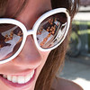 Record-Eagle/Douglas Tesner<br /> Ducks reflect in Lauren Griggs sun glasses, a student at Central Michigan University, as she  sells ducks for the Boardman River Duck Race. The ducks are sold in conjunction with the Optimist Club of Traverse City to raise funds for youth charities.
