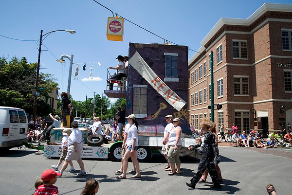 Record-Eagle/Jan-Michael Stump<br /> The Old Town Playhouse Float makes its way down Union Street in Saturday's National Cherry Festival Cherry Royale Parade.
