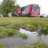 Record-Eagle/Douglas Tesner<br /> A semi-trailer carrying the Thrivent Builds with Habitat for Humanity display is moved into place despite the soggy conditions in the Open Space.