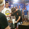 Record-Eagle/Douglas Tesner<br /> Hot dog fans stand in line at the House of Dogs in Traverse City as Dana Page takes orders. According to Page, the business has been very busy during festival.