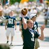 Record-Eagle/Jan-Michael Stump<br /> Traverse City St. Francis quarterback Corey Williams throws a pass to a fan in the crowd as the football team makes its way down Front Street during Saturday's National Cherry Festival Cherry Royale Parade