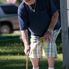 Record-Eagle/Douglas Tesner<br /> Guy Maceroni, of Lansing, took part in a shuffleboard tournament at the Traverse City Senior Center during the National Cherry Festival.