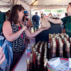 Record-Eagle/Douglas Tesner<br /> Hannah Roman waits on customers at the Gallaghers Farm Market.  According to Roman business was very good on opening day of the National Cherry Festival.