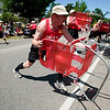 Record-Eagle/Jan-Michael Stump<br /> Members of the National Chair-ry Festival Drill Team perform on Union Street during Saturday's National Cherry Festival Cherry Royale Parade.