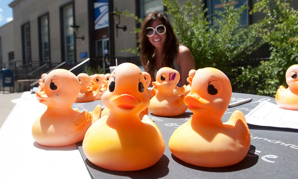 Record-Eagle/Douglas Tesner<br /> Lauren Griggs, a student at Central Michigan University, sells ducks for the Boardman River Duck Race. The ducks are sold in conjunction with the Optimist Club of Traverse City to raise money for youth charities.