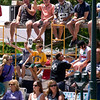 Record-Eagle/Jan-Michael Stump<br /> People on scaffolding along Union Street grade floats as they pass by in Saturday's National Cherry Festival Cherry Royale Parade