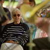 Record-Eagle/Jan-Michael Stump<br /> Winnie Young listens to Northwind Brass during the National Cherry Festival Intergenerational Picnic Wednesday at the Grand Traverse Pavilions.