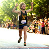 Record-Eagle/Jan-Michael Stump<br /> 5K men's winner Jake Secor of Traverse City crosses the finish line in Saturday's National Cherry Festival Meijer Festival of Races.
