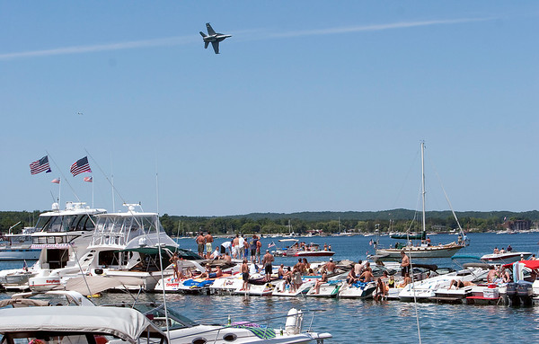 Record-Eagle/Douglas Tesner<br /> Boaters off West End Beach had a clear view of a U.S. Navy F-18 Super Hornet during the National Cherry Festival.
