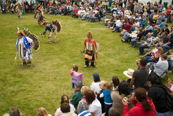 Record-Eagle/Jan-Michael Stump<br /> Crowds watch Tuesday's Native American Pow Wow Dance, presented by the Grand Traverse Band of Ottawa and Chippewa Indians at the Open Space. The event was part of Heritage Day at the National Cherry Festival.