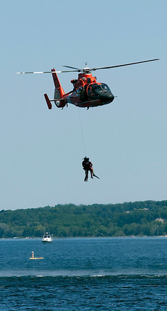 Record-Eagle/Douglas Tesner<br /> A US Coast Guard helicopter from Traverse City puts on a rescue demonstration at the start of the air show.