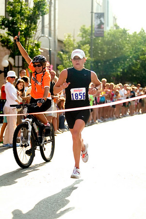 Record-Eagle/Jan-Michael Stump<br /> 15k women's winner Sara Vergote (cq) of Toledo crosses the finish line in Saturday's National Cherry Festival Meijer Festival of Races.