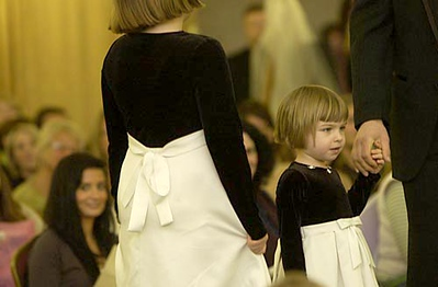 Record-Eagle/Garret Leiva<br /> Amanda Allen, 3, models a flower girl dress during the annual Bridal Fashion Show featuring trends by To Have & To Hold Bridal Boutique & Formal Wear, Captain's Quarters and Bay Bridal Boutique.