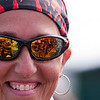 Record-Eagle/Douglas Tesner<br /> Cheryl Miller's sunglasses reflect bikes taking part in the 18th Annual HOG Ride for Father Fred benefiting the Father Fred Foundation.
