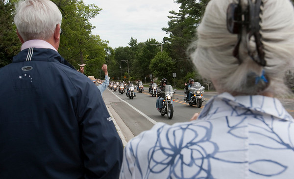 Record-Eagle/Douglas Tesner<br /> Along the way hundreds of people lined the route and greeted bikers as they took part in the 18th Annual HOG Ride for Father Fred.