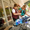 Record-Eagle/Jan-Michael Stump<br /> Jan Harlan and Ann Kalat set up merchandise for the 5th annual Traverse City Film Festival outside the State Theatre. The festival runs July 28 through August 2.