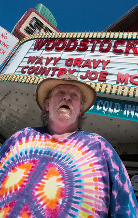 "Record-Eagle/Douglas Tesner<br /> Marc Ryan, 58, waits for the matinee showing of ""Woodstock"" at the State Theatre."