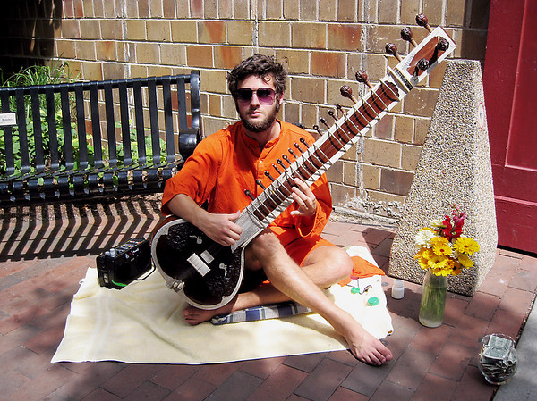Record-Eagle/Jodee Taylor<br /> Will Marsh, 21, of Traverse City, plays the sitar in the Jay Smith Walkway during the Traverse City Film Festival.