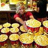 "Record-Eagle photo/Jan-Michael Stump<br /> Meghan Redmond stacks popcorn buckets at the City Opera House before the start of Wednesday evening's screening of ""Enemies, A Love Story."""