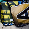 Record-Eagle/Jan-Michael Stump<br /> Messenger bags made from recylced banners sit with other merchandise 5th annual Traverse City Film Festival merchandise for sale Wednesday outside the State Theatre.