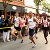 Record-Eagle/Douglas Tesner<br /> Stars of the Mile male runners take off down Front Street near the State Theatre downtown.