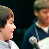 Record-Eagle/Douglas Tesner<br /> Lukas Blakkan-Esser smiles as he spells his word correctly and wins the 28th Annual Grand Traverse Regional Spelling Bee at the City Opera House in Traverse City. Second-place finisher Kalvis Hornburg is in the background.