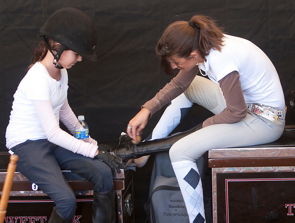 Record-Eagle/Douglas Tesner<br /> Riding horses is only part of Horse Shows by the Bay. Lindsay Tomeu, 15, and Julie Marino, 13, polish riding boots as they get ready to ride.