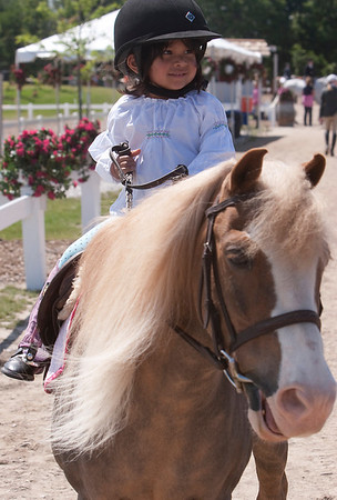 Record-Eagle/Douglas Tesner<br /> Lily Lenkart, 3, is taking part in the show this year. She is riding Blaze, of Wild Oak Farm in Delano, Minn.
