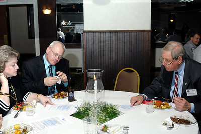 Lee Brown (Western Kentucky University) and KAPA President Mark Harrison discuss legislative bills with Sen. Jerry Rhoads (Sixth District, Senate Minority Whip) during the 2009 KAPA Legislative Reception.