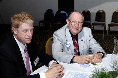 KAPA Board Member Terry Fraley (Netcare Ambulance) and Rep. Hubert Collins (97th District) discuss EMS issues with  Rep. Thomas Burch(30th District, co-char of the House Health and Welfare Committee, not pictured) during the 2009 KAPA Legislative Reception.