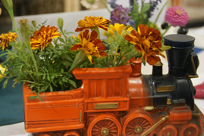 Display of flowers in train planter