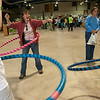 Record-Eagle/Douglas Tesner<br /> Susan Kreitner, her daughter Mckinley, 8, and a family friend Ella Bush, 10, try using hula hops during the Let's Get Moving Northern Michigan kick off Monday at the Grand Traverse Civic Center. Let's Get Moving is a 100-day season of activity that encourages northern Michigan residents to, you guessed it, get moving.