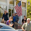 Record-Eagle/Jan-Michael Stump<br /> People watch the Alden Memorial Day parade make its way down Helena Road on Monday afternoon.