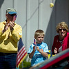 Record-Eagle/Jan-Michael Stump<br /> Ron Lynch, left, his grandson Luke Hasel, 7 and wide Dee Lynch watch Monday's Alden Memorial Day parade on Helena Road.
