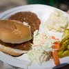 Record-Eagle/Jan-Michael Stump<br /> Attendees of Sunday's 54th Annual NMC Barbecue Sunday on the campus of Northwestern Michigan College had buffalo steakettes, cole slaw, potato salad and baked beans among their food choices.