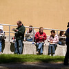Record-Eagle/Jan-Michael Stump<br /> People sit in the sun outside the Mark and Helen Osterlin Library during Sunday's 54th Annual NMC Barbecue on the campus of Northwestern Michigan College.