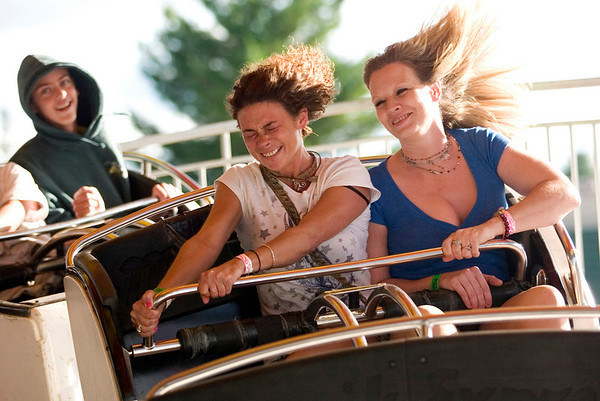 "Record-Eagle photo/Jan-Michael Stump<br /> Chelsea Prainito, left, and Cynthia Willis, both of Traverse City, ride the ""Musik Express."""