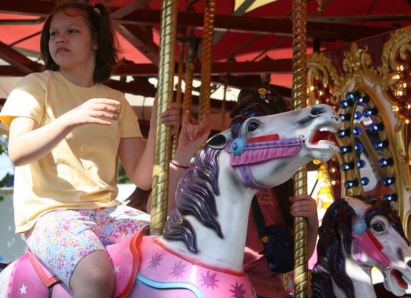 Record-Eagle/Laura Wright<br /> Sarah Hoose, 13, of Mancelona enjoyed the rides and animals at the Northwestern Michigan Fair. Her favorite animals were the bunnies and ponies.