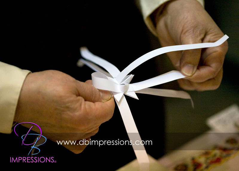 The next few photos demonstrate the folding of a paper star. This lady was quite quick in her folding and has spent many hours perfecting her craft.
