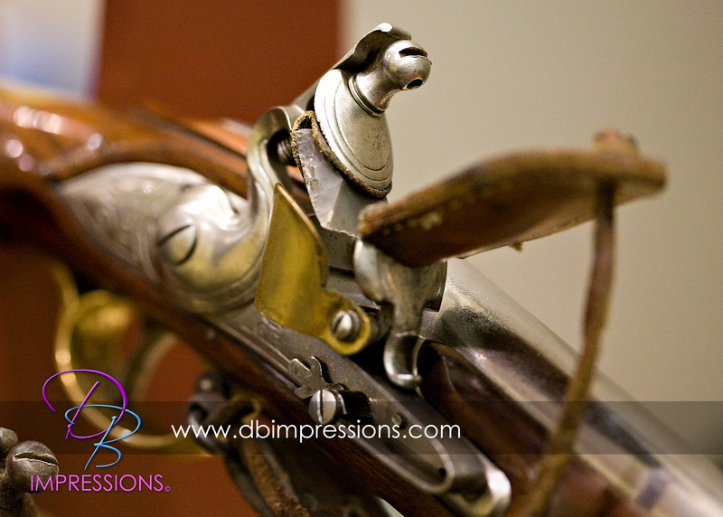 Detail of a reproduction flint lock rifle.