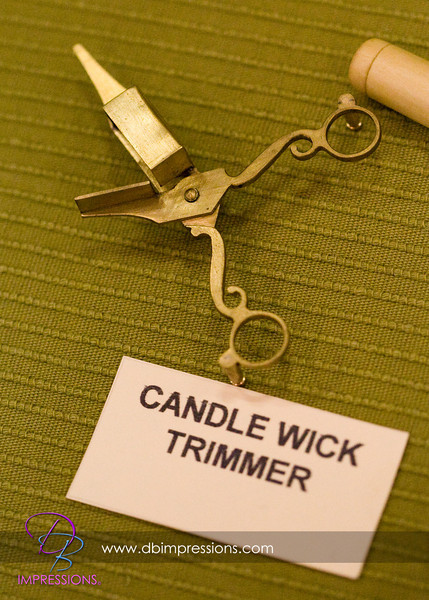 Tiny candle wick trimmer, good if you have a tiny, tiny candle.