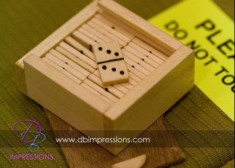 Tiny domino set, hand created, approximately as long as a business card.