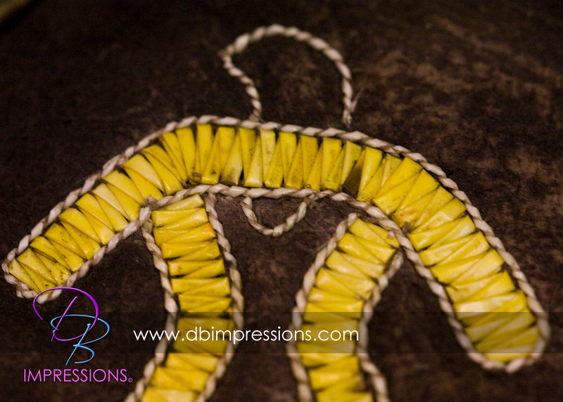 Detail of the porcupine quilling on the hunting pouch.