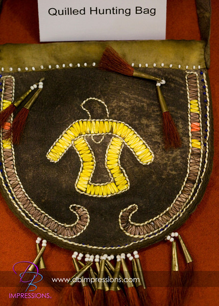 Beautiful leather hunting pouch decorated with naturally dyed porcupine quill decoration.