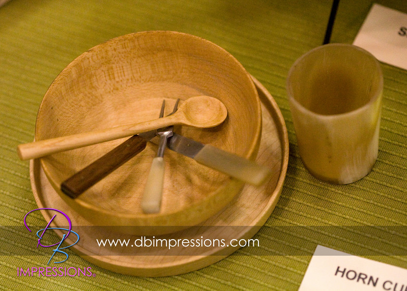Small horn cup with a miniature cup and utensil set.