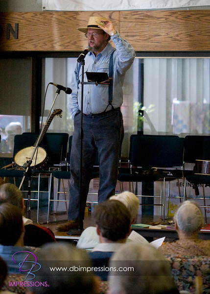 Speaker showing authentic PA German dress and demonstrating a mouth harp.