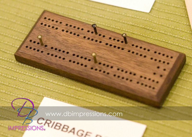 Mini cribbage board, about 4 inches long. Hand-crafted.